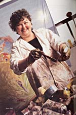 Photograph of Joyce Wieland at work on a painting