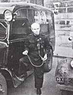 Photograph  of Dr. Norman Bethune beside blood-transfusion truck during Spanish Civil War