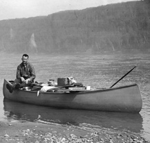 Photograph of Harold Innis canoeing on the Peace River, 1924