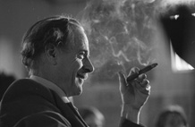 Photograph of Marshall McLuhan smoking a cigar, 1973, by Robert Lansdale