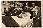 Photograph of Harold Innis in military hospital bed set outdoors, with five male visitors, circa 1918