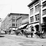 Photograph of the wholesale district with a number of horses and carriages, Vancouver, British Columbia, unknown date