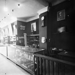 Photograph of the interior of the Topley Studio with photographic equipment for sale, 132 Sparks Street, Ottawa, June 1911