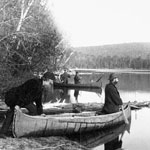 Photograph of six men in three canoes starting out on a deer hunt from the Princess Louise album, Trout Lake, Ontario, ca. 1878-1883