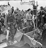 Disembarkation of British commandos upon their return to England.