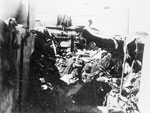 Damaged landing craft. This photograph demonstrates the fire-power that was awaiting the Allied Forces when they landed. The defensive fire of the German troops was so powerful that some men were killed even before disembarking from the landing craft.