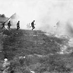 Photograph showing soldiers entering a smoke-filled area, France, 1916