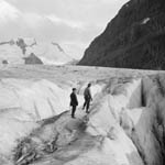 Photograph of two men standing on a glacier on Mount Robson, British Columbia, 1913