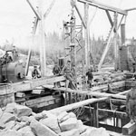 Photograph showing the construction of the Miramichi railroad bridges, Newcastle, New Brunswick, 1873