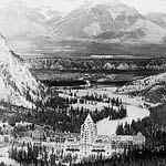 Photograph of the Banff Springs Hotel in winter surrounded by mountains, Banff, Alberta, date unknown