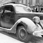 Photograph of a snow-covered car used by W.B. Edwards in his commercial photography business, Québec, date unknown