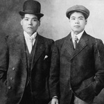 Photograph of two Japanese men wearing suits, 1910