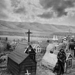 Photograph of an Aboriginal man standing in a graveyard, Fort Qu'Appelle, Saskatchewan, circa 1885