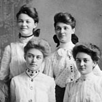 Photograph of six well-dressed women with upswept hairstyles, Toronto, 1908