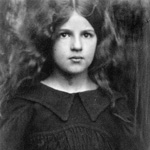 Photograph of a young girl wearing a dark dress, 1905