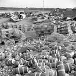 Photograph showing fishing shacks, boats, lobster pots and buoys on the shore, Sandford (near Yarmouth), Nova Scotia, 1948