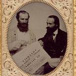Framed photograph of two men examining a broadsheet announcing a farm auction, Fonthill, Ontario, circa 1856