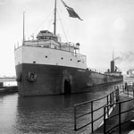 Photograph of a ship, the W.H. BECKER, going through a canal, 1930