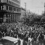 Photograph of a large crowd outside the Union Bank of Canada building during the Winnepeg General Strike, Winnepeg, 1919