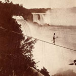 Stereograph showing a man crossing Niagara Falls on a tightrope, 1873