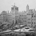 Photograph of the Centre Block of the Parliament Buildings under construction, Ottawa, Ontario, 1865