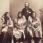 Photograph of three Aboriginal chiefs and a White man posing for the photographer, Brantford, Ontario, 1886