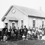 Photograph of teachers and male and female students outside a one-room school, Edmonton, Alberta, circa 1896