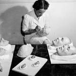 Photograph of Agnes Roberge making plaster casts, Toronto, 1944