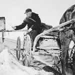 Photograph of a man using a horse and buggy to deliver the mail in early spring, Vernon, Ontario, 1947