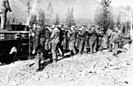 Photograph of soldiers lifting the steel from a Canadian National Railway line, around 1917