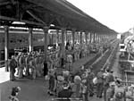 Photograph of troops standing on the platform waiting for a train, Montréal, 1942