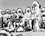 Prime Minister Lester Pearson receiving honorary membership in the Blackfoot Confederacy, July 18, 1966.