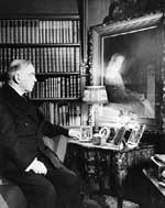Mackenzie King with the Forster painting of his mother, Mrs. John King, in his library at Laurier House, ca. 1945.