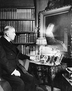 Mackenzie King looking at a portait of his mother