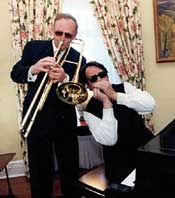 Some blues brothers: Prime Minister Jean Chrétien and actor/musician Dan Aykroyd, 1999.